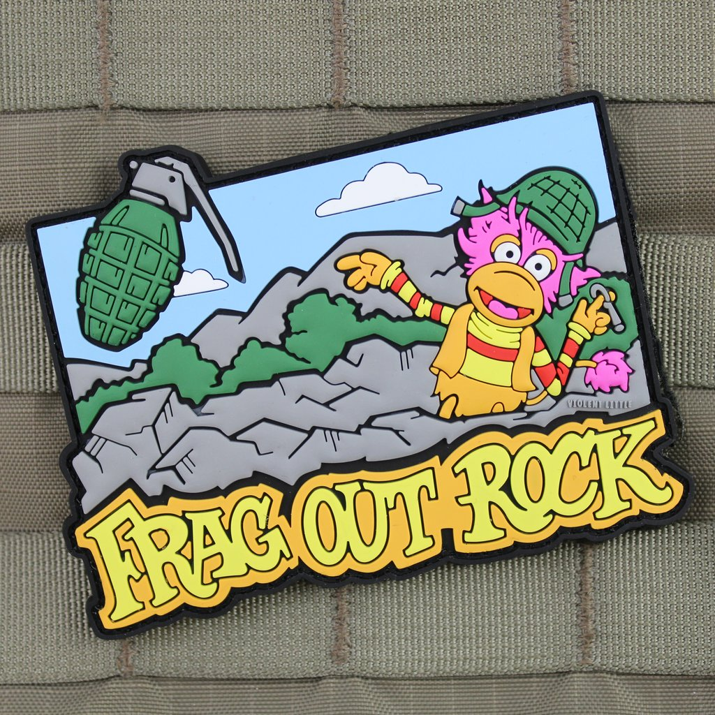 "VIOLENT LITTLE MACHINE SHOP DEBUTS NEW ""FRAG OUT ROCK"" MORALE PATCH"